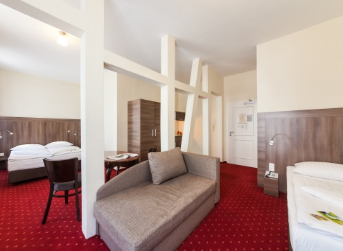 Novum Hotel City Apart Comfort Quadruple Room