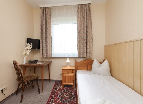 Novum Hotel Hagemann Zimmer mit Gemeinschaftsbad